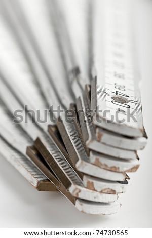 close up macro shot of a white folding rule #74730565