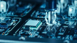 Close-up Macro Shot of Electronic Factory Machine at Work: Printed Circuit Board Being Assembled with Automated Robotic Arm, Place Technology Mounts Microchips to the Motherboard