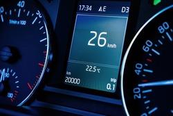Close-up macro shot of new car dashboard computer display with 20000 kilometers mileage