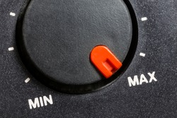 Close up macro view of vintage tape machine volume dial set to MAX.