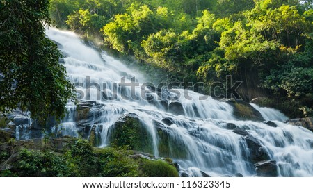 close up maeya water fall of chiang mai thailand with sun light