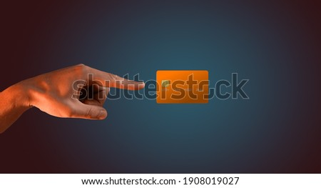 Close up male hand and levitating template mockup bank credit card with online service isolated on blue background