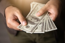 Close up male hand Counting money us dollar. Financial business concept.