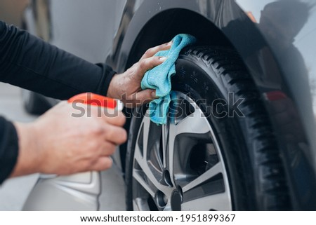 close up man cleaning car tires in carwash service Stock fotó ©