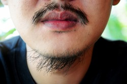 Close-up man's face with mustache and  beard chin,