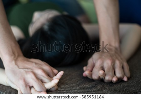 Close up man's hand holding a woman hand for rape and sexual abuse concept. #585951164