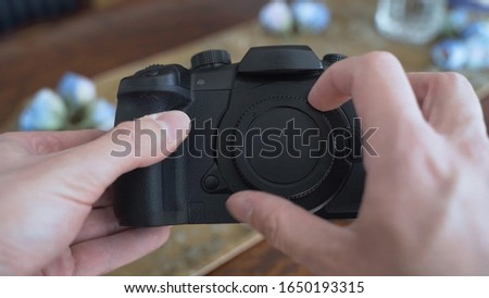 Close-Up Man's Hands removing lens cap from the lens