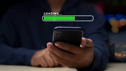 Close up man using mobile smartphone for download application and waiting to loading. loading bar symbol. businessman downloading digital business data form website and cloud to smartphone.