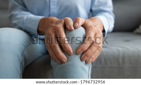 Close up mature old woman touching knee joint, having painful feelings. Unhealthy middle aged senior female retiree suffering from arthritis, bones disease osteoporosis or inflammation processes. Сток-фото ©