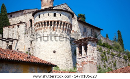 Close up. Medieval castle (Castello di Brescia) with battlements, a tower, drawbridge & ramparts, plus an arms museum in the keep. Brescia, Lombardy, Italy. Italian architecture. Roman ancient castle. #1470105629