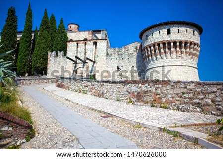 Close up. Medieval castle (Castello di Brescia) with battlements, a tower, drawbridge & ramparts, plus an arms museum in the keep. Brescia, Lombardy, Italy. Italian architecture. Roman ancient castle. #1470626000