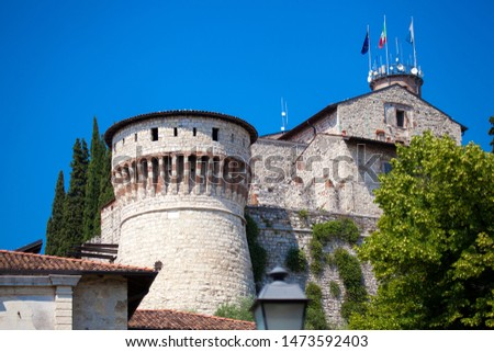 Close up. Medieval castle (Castello di Brescia) with battlements, a tower, drawbridge & ramparts, plus an arms museum in the keep. Brescia, Lombardy, Italy. Italian architecture. Roman ancient castle. #1473592403