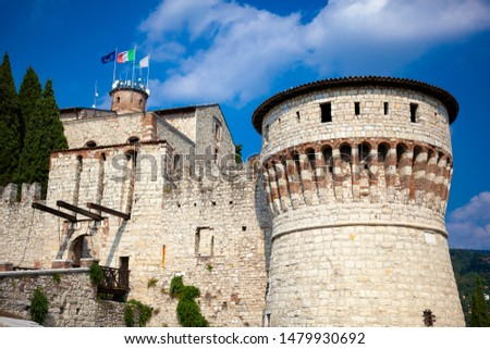 Close up. Medieval castle (Castello di Brescia) with battlements, a tower, drawbridge & ramparts, plus an arms museum in the keep. Brescia, Lombardy, Italy. Italian architecture. Roman ancient castle. #1479930692