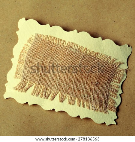 close up mesh texture on brown recycled kraft paper background, square toned image, instagram effect