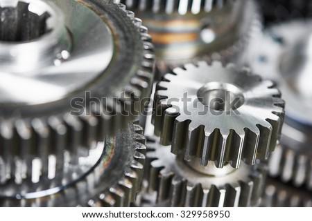 close-up metal cog wheels gears #329958950
