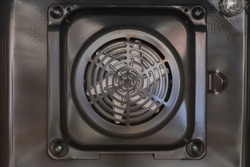 Close-up metal fan of electric oven