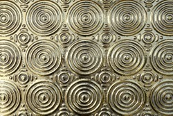 close up metal surface with embossed golden concentric circle layered pattern, elegance gold metallic wall for interior home decor oriental style, abstract texture background