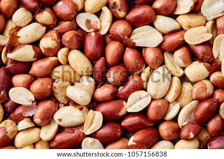 Close up mixed peanuts background, top view, food background.