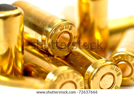 Close-up 9mm bullet on white