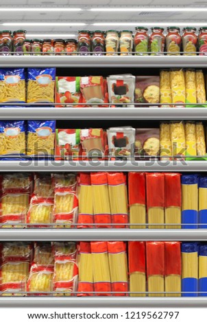 Close up/Mock up Pasta packing on a shelf in a supermarket. Suitable for presenting new packaging designs and product among many others  #1219562797