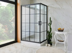 Close up modern grid shower in the white ceramic bath room.