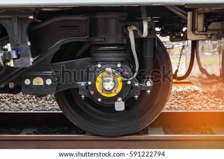 Close up modern wheel train system on track