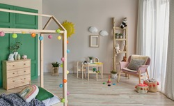 Close up Montessori and wooden house bed style for young room interior.