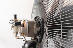 Close-up motor fan Repair and maintenance of home appliances for fixing the fan,  nut and wire copper roll of motor fan on background