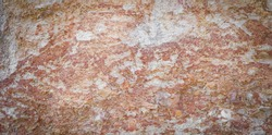 Close up natural rock strata texture on limestone mountain background, vignette.