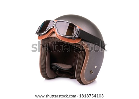Close up new grey vintage helmet and wind goggle. Studio shot isolated on white background