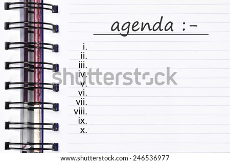 Close up note book and list of agenda