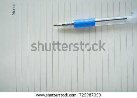 close up notebook ,notepad, writing pad, drawing pad or legal pad on the table #725987050