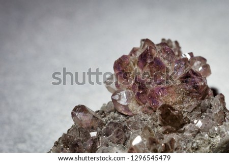 Close up of a amethyst rock. Amethyst and texture concepts. #1296545479