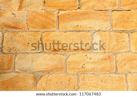 Close up of a ancient sandstone wall. Classic handmade work.