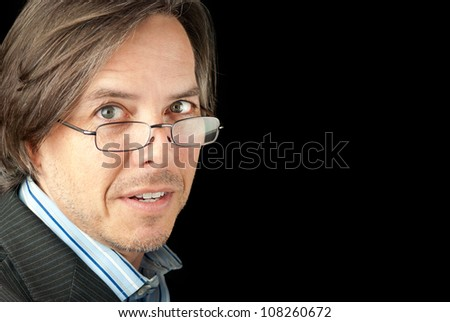 Close-up of a anxious businessman wearing glasses looking to camera.