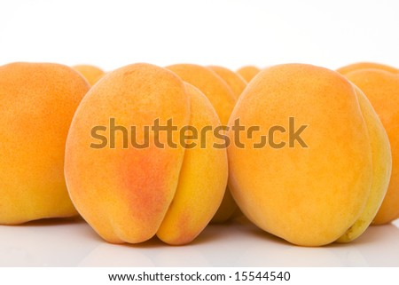close up of a apricots against white background