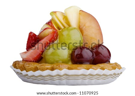 Close-up of a baked fruit tart in paper cup, isolated against white background (with clipping path)
