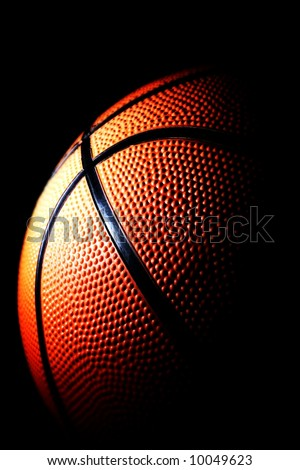 close-up of a basketball against a dark background vertical