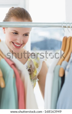 Close-up of a beautiful female customer selecting clothes at store