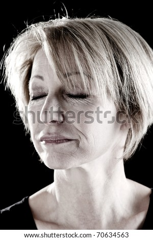 Close-up of a beautiful mature woman with eyes closed, portrait/actress on stage