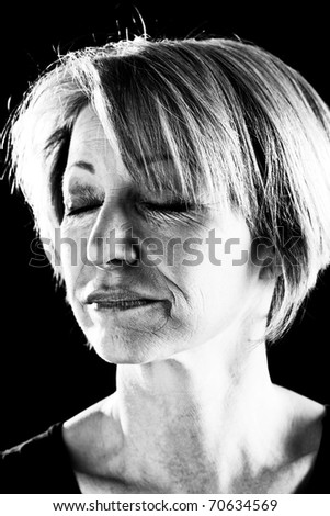 Close-up of a beautiful mature woman with eyes closed, portrait/actress on stage-black and  white image
