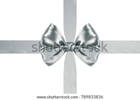 close up of a beautiful silver satin ribbon bow with crosswise ribbons on white background #789833836