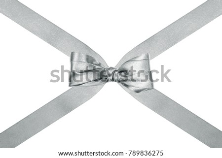 close up of a beautiful silver silk ribbon bow with crosswise ribbons on white background #789836275