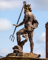 Close-up of a beautiful statue of Neptune the God of the Sea, located on Market Place in the historic city of Durham, UK.