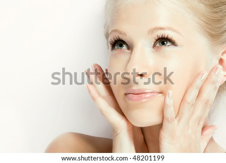 Close-up of a beautiful young fresh face - stock photo