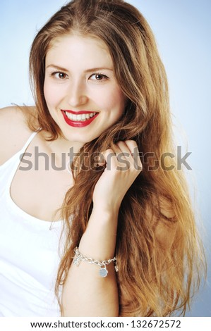 Close-up of a beautiful young woman smiling