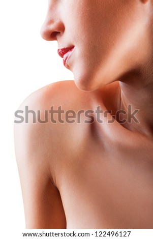 Close-up of a beautiful young woman with a perfectly clean skin on a white background