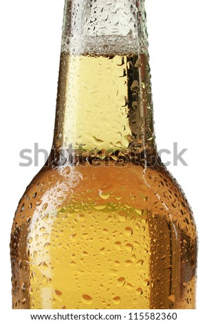 Close-up of a beer bottle with waterdrops isolated on white background