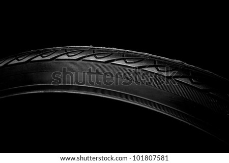 Close up of a bike tire detail on black background