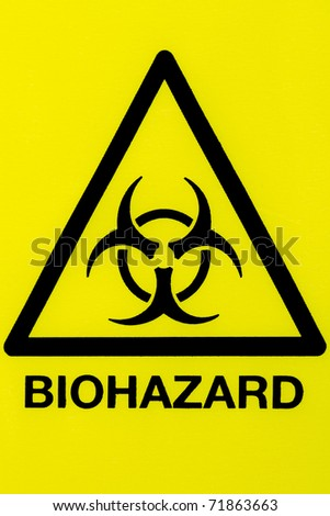 Close up of a biohazard symbol in a warning triangle black on yellow